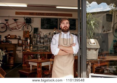 Proud Cafe Owner Standing In The Doorway
