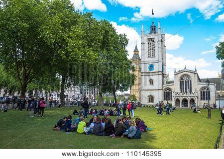Unidentified Tourists  Tourists Resting On The Grass Near Westminster Abbey
