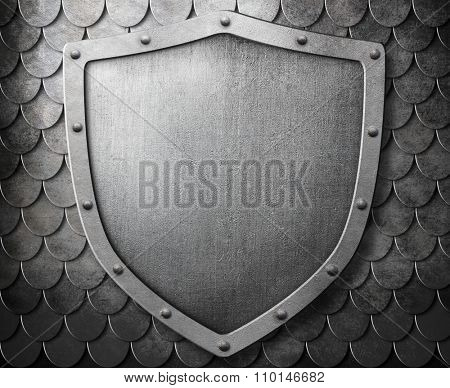medieval coat of arms shield over metal scales background