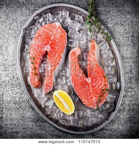Raw Trout Stakes With Lemon And Rosemary On Metal Tray.