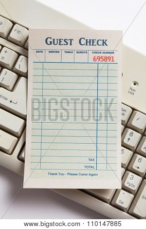 Blank Guest Check And Computer Keyboard