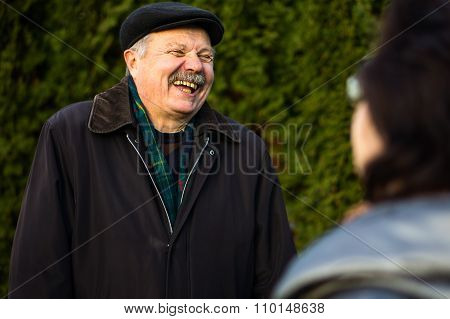 Happy Senior Man With A Beaming Smile