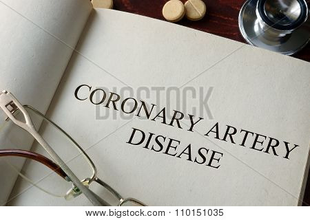 Book with diagnosis coronary artery disease.