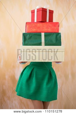 Woman holding present boxes