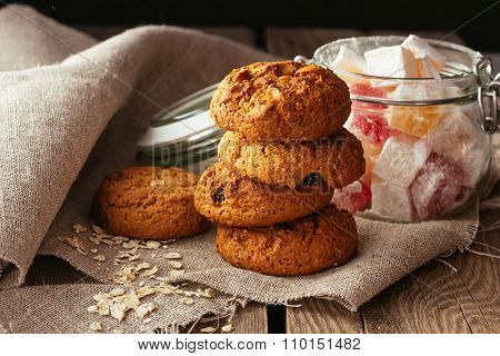 Oatmeal Biscuits And Jar With Sweeties On Linen Cloth