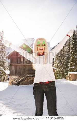 Woman In A Funny Christmas Glasses In Front Of A Mountain House