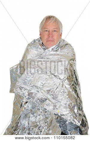 Lost hiker wrapped in an emergency survival blanket, isolated on white