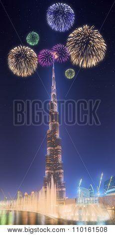 Beautiful fireworks above dancing fountain Burj Khalifa in Dubai, UAE