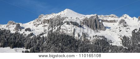 Snow Cowered Mountains In The Toggenburg Valley