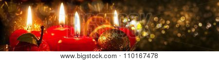 Four Advent candles with christmas decoration .