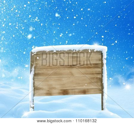 Winter christmas  landscape with wooden sign