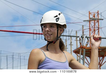 At Rope Adventure Park A Young Woman Looking Back