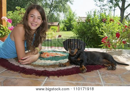 Young Woman And A Young Dachshund Dog