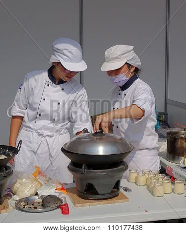 Two Female Chefs Prepare A Steamer