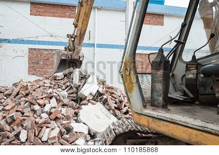 Excavator Demolishing Concrete And Brick Rubble Debris Horizontal