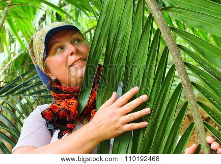 Farmer on a palm oil plantation. Tropical agriculture in The Africa.