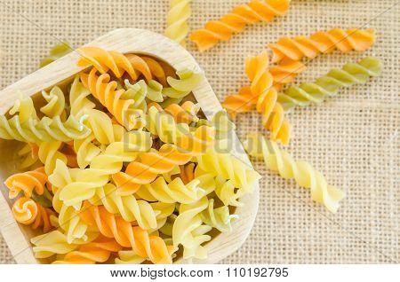 Raw Italian Colorful Pasta, Macaroni In Wooden Cup.