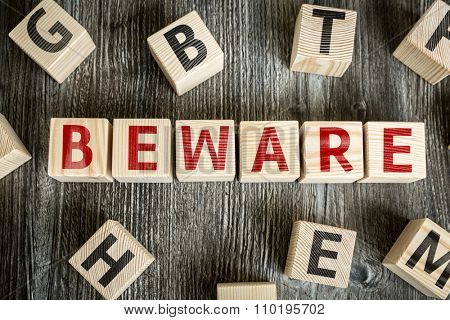 Wooden Blocks with the text: Beware