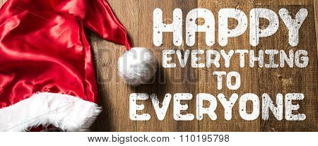 Happy Everything to Everyone written on wooden with Santa Hat