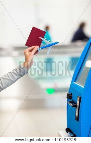 Closeup passport doing check-in for flight or buying airplane tickets at airport