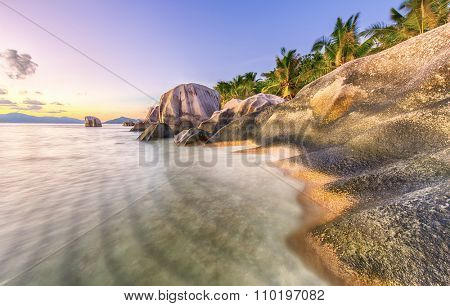 Beautifully shaped granite boulders during sunset  at Anse Source d'Argent beach, La Digue island, Seychelles. Long exposure