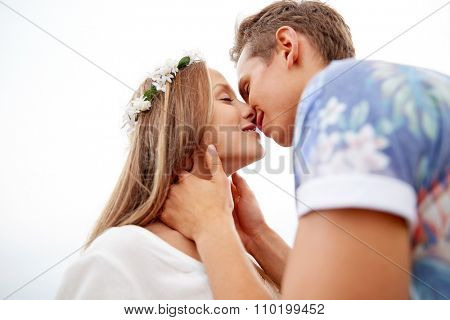 summer holidays, love, romance and people concept - happy smiling young hippie couple kissing outdoors