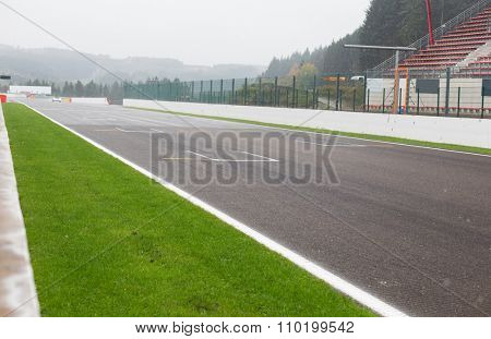 motosports, extreme and race concept - close up of speedway track or road and stands