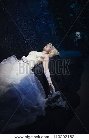 Sleeping Beauty. Beautiful Lifeless Bride In White Dress Lying On The Shore In A Tomb
