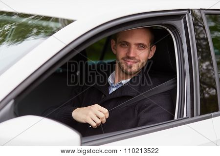 Young Man Fasten Seat Belt In Her Car