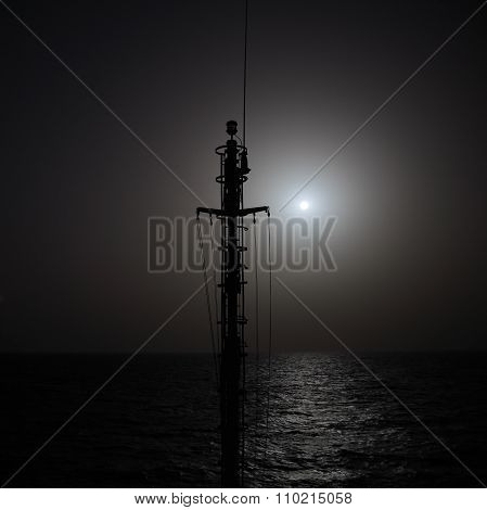 Outlines Of Ship Mast Against Setting Sun. Nautical Background.