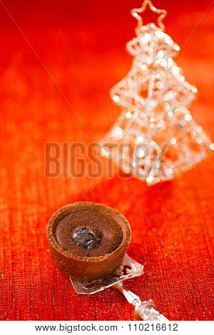 Chocolate  Mini Tartlets in vintage spoon with festive golden red style, shallow dof