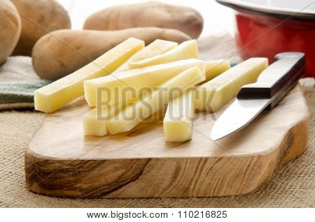Home Made French Fries On Wooden Board