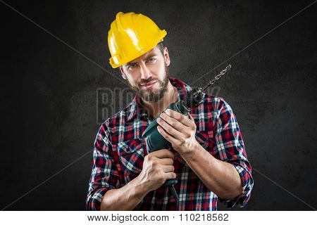 Portrait Of Young Workman With Drill