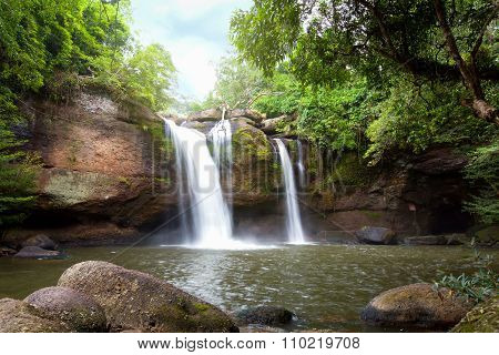 Natural Water Fall Flare In The Forest Mountain.