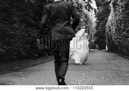 Gorgeous Stylish Blonde Bride In Vintage White Dress And Elegant Groom Walking In The Park