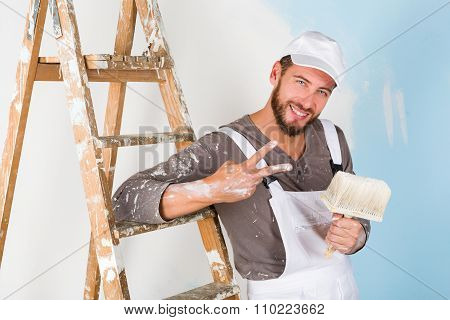 Painter In White Dungarees With Victory Gesture