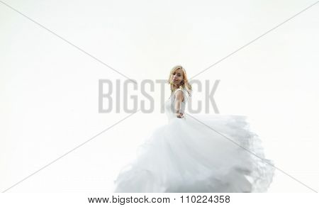 Beautiful Angel Blonde Stylish Bride In An Elegant Dress Front Of White Sky, Midair
