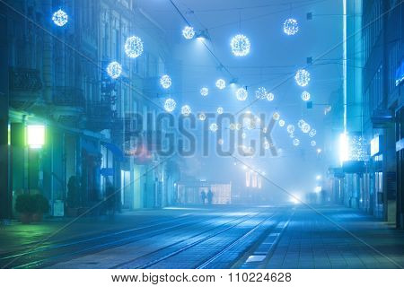Holiday fairy lights over the street