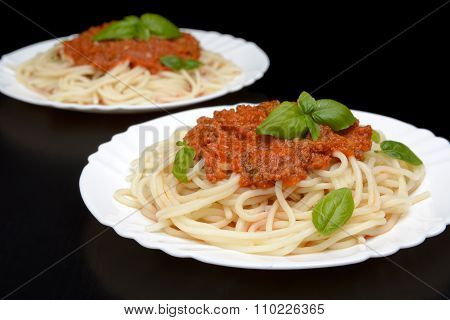 Two Dish Pasta With Bolognese Sauce On Black