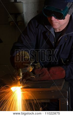 Close Up Of Welder With Orange Sparks