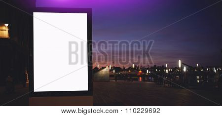 Public information board with night city on background