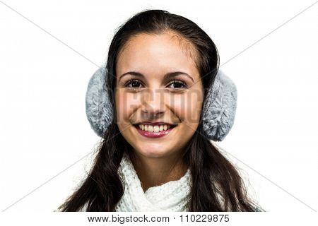Smiling woman with earmuffs on white screen