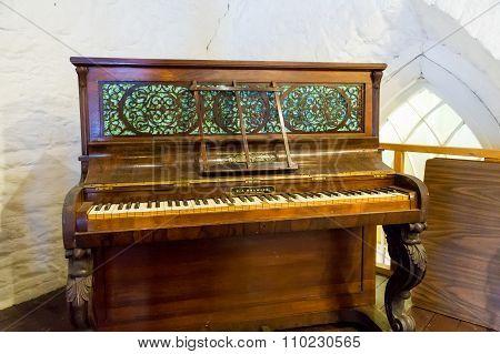 Antique Piano In Church