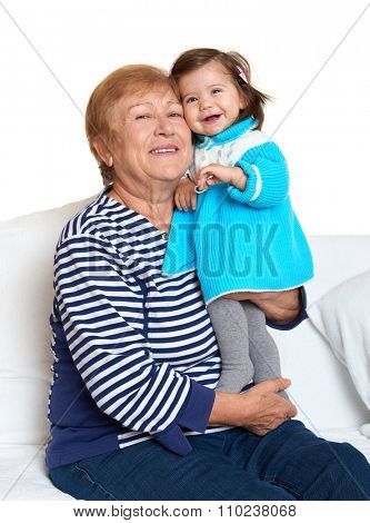 portrait of baby girl and grandmother on white, happy family concept