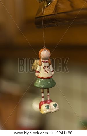 Christmas ornaments - toy girl with a heart on her chest and ponytails