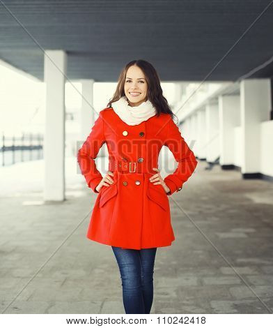 Beautiful Smiling Young Woman Wearing A Red Coat And Scarf In City
