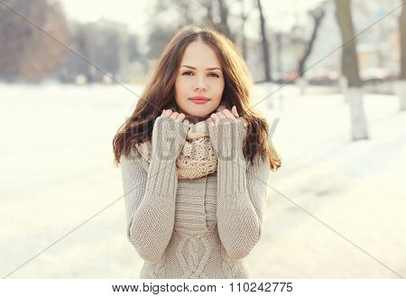 Pretty Woman Wearing A Knitted Sweater And Scarf Outdoors In Winter Day