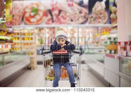 Adorable Little Boy, Sitting In A Shopping Cart
