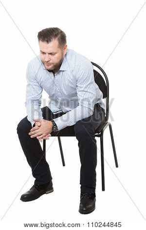man sitting on chair. Isolated white background. Body language. gesture. rubbing hands