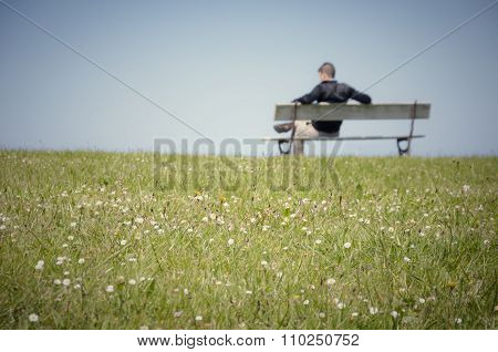 Man sitting on a bench-3